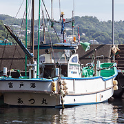 Inaba-san's boat tied-up at Futo Harbor. The name of the vessel is Atsu-maru. Inaba-san also goes by the name Atsumaru-san. As is the case with other fishermen in Japan, the vessel is the center of Inaba-san's life.