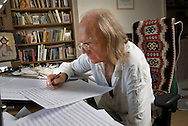 Composer Sir John Tavener in his study at his home in Child Okeford, Dorset, UK.