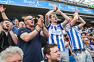 Brighton fans celebrate when Dale Stephens scores to make it 1-1 during the live beamback at the American Express Community Stadium in Brighton during the Sky Bet Championship match between Middlesbrough and Brighton and Hove Albion at the Riverside Stadium, Middlesbrough, England on 7 May 2016. Photo by Bennett Dean.