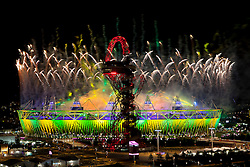 © Licensed to London News Pictures.12/08/2012 LONDON UK.The London Olympic Stadium is lit with Brazilian national colours as the Olympic flag is passed from London to Rio during the closing ceremony of the London Olympic Games. Photo credit : Andrew Baker/LNP : Andrew Baker/LNP