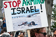 Protest against Israel's latest attack on Gaza, July 19th 2014 , Operation Protective edge. A man holds a placard with a picture of one of the boys killed on the beach.