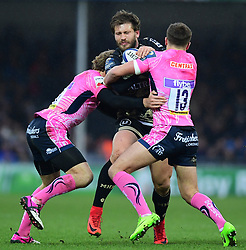 Frans Steyn of Montpellier is tackled by Lachie Turner of Exeter Chiefs and Henry Slade of Exeter Chiefs  - Mandatory by-line: Alex Davidson/JMP - 13/01/2018 - RUGBY - Sandy Park Stadium - Exeter, England - Exeter Chiefs v Montpellier - European Rugby Champions Cup