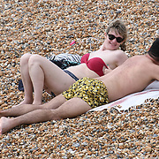 UK weather: People sunbathe at the Brighton pier as Heatwaves continues in in UK on July 27 2018.