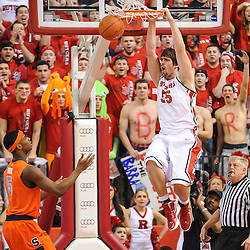 Rutgers Scarlet Knights forward Gilvydas Biruta (55) slam dunks during first half NCAA Big East basketball action between #2 Syracuse and Rutgers at the Louis Brown Athletic Center. Syracuse leads 40-34 at halftime.