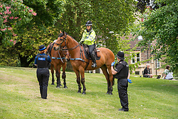 © Licensed to London News Pictures; 16/05/2020; Bristol, UK. Police with horses patrol on Brandon Hill in Bristol, one of two locations in the city where a mass gathering protest against the lockdown restrictions of the Covid-19 coronavirus pandemic had been advertised. No mass gathering was visible, but there was a small protest gathering elsewhere in the city in Victoria Park. Restrictions have been eased by the UK government but people should still not gather in groups of more than two people not in the same household or in groups of more than two people outside of their own household. Photo credit: Simon Chapman/LNP.