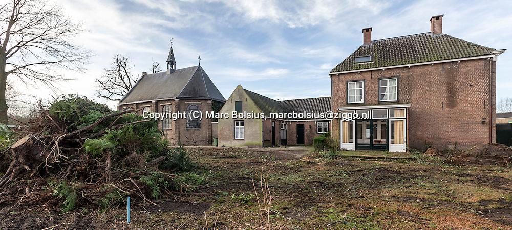 Nederland,  Sint Michielsgestel,in de pastorie tui achter de protestantsekerkje heeft een kaalslag plaats gevonden. Vooral oude bomen legeden het loodje.