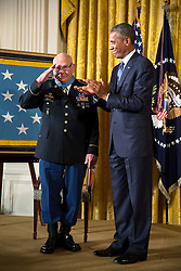 President Barack Obama presents the Medal of Honor to Army Command Sergeant Major Bennie Adkins during a ceremony in the East Room of the White House, Sept. 15, 2014. (Official White House Photo by Pete Souza)<br /> <br /> This official White House photograph is being made available only for publication by news organizations and/or for personal use printing by the subject(s) of the photograph. The photograph may not be manipulated in any way and may not be used in commercial or political materials, advertisements, emails, products, promotions that in any way suggests approval or endorsement of the President, the First Family, or the White House.