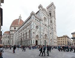 "THEMENBILD - Die Kathedrale Santa Maria del Fiore (italienisch Cattedrale di Santa Maria del Fiore) in Florenz ist die Bischofskirche des Erzbistums Florenz und somit Metropolitankirche der Kirchenprovinz Florenz. Ihre gewaltige weltbekannte Kuppel, das Hauptwerk Brunelleschis, gilt als technische Meisterleistung der frühen Renaissance. Hier im Bild Westfassade ist ein Anbau aus dem späten 19. Jahrhundert, der den gotischen Stil des Langhauses imitiert und die Gestaltung in dreifarbigem Marmor aufgreift. Sie wurde nach einem Entwurf von Emilio de Fabris 1887 vollendet. Aufgenommen am 18. Oktober 2015 // SThe Cattedrale di Santa Maria del Fiore (English, ""Cathedral of Saint Mary of the Flower"") is the main church of Florence, Italy. Il Duomo di Firenze, as it is ordinarily called, was begun in 1296 in the Gothic style to the design of Arnolfo di Cambio and completed structurally in 1436 with the dome engineered by Filippo Brunelleschi. The exterior of the basilica is faced with polychrome marble panels in various shades of green and pink bordered by white and has an elaborate 19th-century Gothic Revival façade by Emilio De Fabris. The cathedral complex, located in Piazza del Duomo, includes the Baptistery and Giotto's Campanile. The three buildings are part of the UNESCO World Heritage Site covering the historic centre of Florence and are a major attraction to tourists visiting the region of Tuscany. The basilica is one of Italy's largest churches, and until development of new structural materials in the modern era, the dome was the largest in the world. It remains the largest brick dome ever constructed.. Pictured on 18. October 2015. EXPA Pictures © 2015, PhotoCredit: EXPA/ Johann Groder"