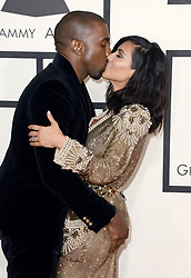 File photo dated February 8, 2015 of Kanye West and Kim Kardashian attend the 57th Annual Grammy Awards at the Staples Center in Los Angeles, CA, USA. US rapper Kanye West took to Twitter over the weekend to announce he was running for president, with his declaration quickly going viral and prompting a flurry of speculation. His wife Kim Kardashian West and entrepreneur Elon Musk endorsed him. Photo by Lionel Hahn/ABACAPRESS.COM