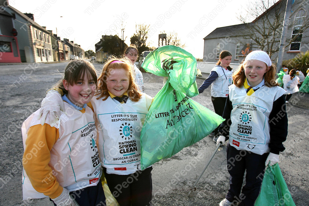 Brid Hayes with Ciara and Roisin O'Sullivan of the Ibrickane Brownies and Girl Guides cleaning up Mullagh village as part of the National Spring Clean.<br /><br />Photograph by Eamon Ward