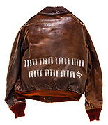 """This type A-2 flight jacket belonged to Kyle N. """"Dixie"""" Anderson, a member of the 570th Squadron attached to the 390th Bomb group. On the front of the jacket is a name plate reading """"Dixie Anderson"""" and the 570th Squadron insignia patch. There are 35 bombs painted on the back of the jacket signifying the 35 missions he completed. There is also one swastika painted on the back signifying a destroyed enemy aircraft. Anderson also served in the Korean and Vietnam wars, amassing a total of 211 completed mission before retiring in 1969."""