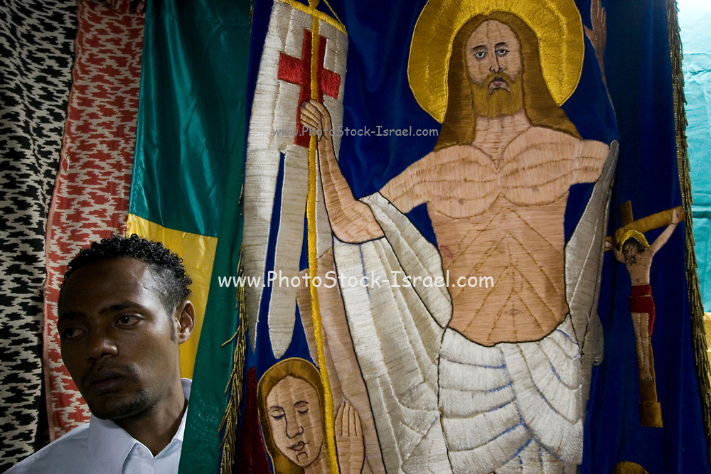 The ceremony of the Holy fire at the Ethiopian Church, Jerusalem, April, 2006. Christian pilgrims commemorated Good Friday in the walled Old Jerusalem, during the ceremony of the Holy Fire. Orthodox Christian worshippers and clergymen hold candles as they gather around the tomb, during the Ceremony of the Holy Fire in the Church of the Holy Sepulchre, traditionally believed by many Christians to be the site of the crucifixion and burial of Jesus Christ, in Jerusalem's Old City, Saturday, April 22, 2006. The ceremony is meant to assure the worshippers that Jesus has not forgotten them and is sending a message of hope through the fire