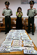 SHENZHEN, CHINA - JUNE 07: (CHINA OUT) <br /> <br /> A woman is arrested as she tied 220,000 US dollars on legs on June 7, 2016 in Shenzhen, Guangdong Province of China. Armed police of Guangdong Frontier Defense Bureau arrested a woman tying 220,000 US dollars on her legs and a woman hiding over 3,000 memory cards at her private part when they were checked at the entry to Shenzhen on Tuesday. <br /> ©Exclusivepix Media