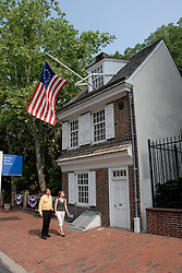Betsy Ross House, couple passing, mod rel..Philadelphia, Pennsylvania, PA USA.  Photo copyright Lee Foster, 510-549-2202, lee@fostertravel.com, www.fostertravel.com. Photo 275-30240