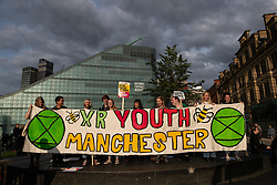 © Licensed to London News Pictures . 03/06/2019. Manchester, UK. An Extinction Rebellion Youth Manchester banner is unfurled . A Manchester Together Against Trump demonstration in Cathedral Gardens , central Manchester , during the first day of US President Donald Trump's visit to the UK . Photo credit: Joel Goodman/LNP