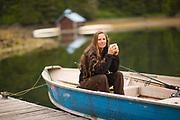 Woman, Boat & floating boat house, Sitka, Alaska