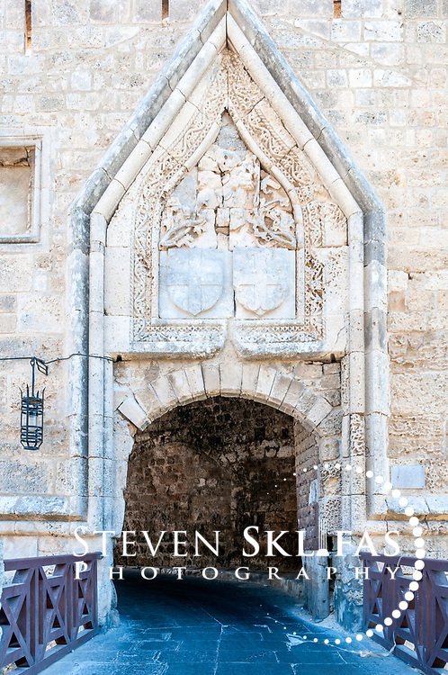 Rhodes. Greece. The 1457 Gate of St John Koskinou with the coat of arms of the Grand Masters at Rhodes town. The gate is situated on the south side of the old walled medieval town of Rhodes. The old town is a UNESCO world heritage listed site and the best preserved, oldest and largest living medieval city in Europe.