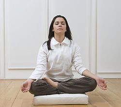 Feb. 22, 2008 - Woman sitting in lotus position. Model and Property Released (MR&PR) (Credit Image: © Cultura/ZUMAPRESS.com)