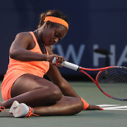Sloane Stephens, USA, wearing an array of matching orange, falls during her match against Julia Goerges, Germany, during the New Haven Tennis Open at Yale, Connecticut, USA. 20th August 2013. Photo Tim Clayton