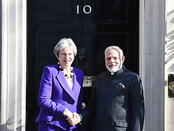 April 18, 2018 - London, London, United Kingdom - Theresa May Meets Narendra Modi. Downing Street...Prime Minister Theresa May welcomes Indian President Modi to Number 10 Downing Street. Modi is in the UK to attend the Commonwealth Heads of Government summit, along with leaders and delegates from 53 Commonwealth nations. (Credit Image: © Pete Maclaine/i-Images via ZUMA Press)