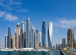Daytime skyline of many modern skyscrapers in Marina district of Dubai United Arab Emirates