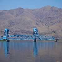 The first vertical lift drawbridge in the inland Pacific Northwest, this drawbridge only lifted a few times before the riverboats operating in this section were made obsolete by dams and locks further upstream. A bridge first spanned this section of the Snake river in 1899, linking the two cities named after some of America's most intrepid explorers.