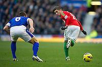Swansea City's Pablo Hernandez tries a back heel past Everton's Phil Jagielka .- CREDIT - CameraSport - Stephen White..Football - Barclays Premiership - Everton v Swansea City - Saturday 12th January 2013 - Goodison Park - Liverpool..