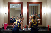 Emma McLean and Olivia Karas of the Michigan Wolverines prepare before their meet at the Crisler Center on December 2, 2018 in Ann Arbor, Michigan.