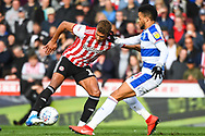 Brentford Forward Oliver Watkins (11) and Queens Park Rangers Midfielder Jordan Cousins (8) battle for the ball during the EFL Sky Bet Championship match between Brentford and Queens Park Rangers at Griffin Park, London, England on 2 March 2019.