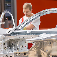 Worker assembles a car belonging to the Audi TT family in the Audi factory in Gyor (about 120 km West of Budapest), Hungary on November 05, 2014. ATTILA VOLGYI