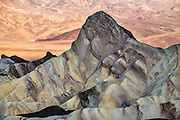 Manly Beacon at sunrise seen from above Zabriskie Point in Death Valley National Park, California, USA.