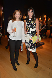Left to right, STACI PERKINS-SURLA and COLLEEN BASSETT at a party to celebrate the publication of Interiors For Living by Joanna Wood held at Christie's. 8 King Street, St.James's, London on 2nd March 2015.