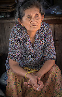 MAE KLONG - TAHILAND - CIRCA SEPTEMBER 2014: Woman seating in the streets of the Maeklong Railway Market