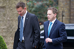 © Licensed to London News Pictures. 18/03/2014. London, UK. The Health Secretary, Jeremy Hunt (L), and Conservative Party Chairman, Grant Shapps, arrive for a meeting of the British cabinet on Downing Street in London today (18/03/2014). Photo credit: Matt Cetti-Roberts/LNP