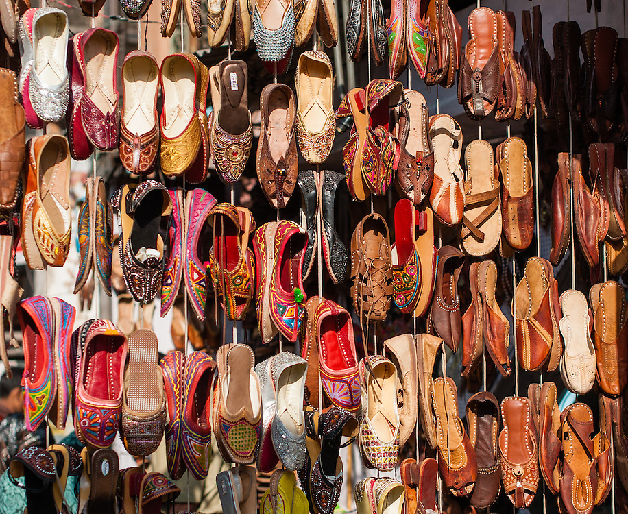 Shoes hanging at street stall (India)
