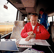 Pilot of the Red Arrows, Britain's RAF aerobatic team checks timings of forthcoming airshow display in team coach.