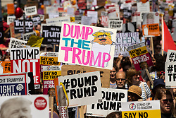 """© Licensed to London News Pictures . 13/07/2018. London, UK. """"Dump the Trump """" placard . Demonstrators march from Portland Place to Trafalgar Square in protest against US President Donald Trump's UK visit . Photo credit: Joel Goodman/LNP"""