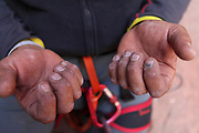 The rough and Callus hands of a rock climber. Photographed in Wadi Rum, Jordan