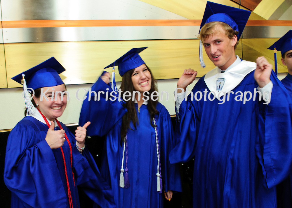 Eileen Barcenes, left Tanya Balderez and Ross Baird give a little cheer while lining up at the Friendswood High School Graduation held at Moody Gardens.