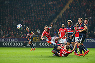 A big scramble for the ball as Charlton Athletic defender Patrick Bauer (5) heads the ball during the EFL Sky Bet League 1 second leg Play-Off match between Charlton Athletic and Doncaster Rovers at The Valley, London, England on 17 May 2019.
