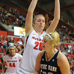 Rutgers Scarlet Knights forward/center Christa Evans (20) posts up to defend Notre Dame Fighting Irish guard Brittany Mallory (22) during first half NCAA Big East women's basketball action between Notre Dame and Rutgers at the Louis Brown Athletic Center. Notre Dame leads 40-23 at halftime.