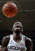 Connecticut's Amida Brimah reacts after dunking in the first half of an NCAA college basketball game against North Florida, Sunday, Dec. 18, 2016, in Storrs, Conn. (AP Photo/Jessica Hill)