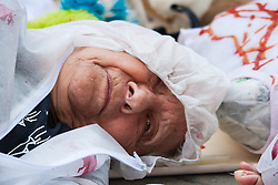 London, August 4th 2014. A woman from British Jews Against Genocide lies on the ground during a die-in outside the offices of the Board of Deputies of British Jews, protesting agisnst their support for Israel's ongoing attacks against Palestine.