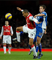 Photo: Ed Godden.<br /> Arsenal v Portsmouth. The Barclays Premiership. 16/12/2006. Arsenal's Gilberto (L), is tackled from behind by Sean Davis.