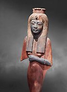 Ancient Egyptian voitive statue of Nefratari, New Kingdom, 19th -20th Dynasty, (1292-1076 BC, Deir el-Medina. Egyptian Museum, Turin. Cat 1349. Grey background.<br /> <br /> Queen Ahmose Neferatari, wife and mother of Amenhoptec I show the great devotion she was held in by ancient Egyptians. The inscription on the base name the dedicators of the statue .<br /> <br /> If you prefer to buy from our ALAMY PHOTO LIBRARY  Collection visit : https://www.alamy.com/portfolio/paul-williams-funkystock/ancient-egyptian-art-artefacts.html  . Type -   Turin   - into the LOWER SEARCH WITHIN GALLERY box. Refine search by adding background colour, subject etc<br /> <br /> Visit our ANCIENT WORLD PHOTO COLLECTIONS for more photos to download or buy as wall art prints https://funkystock.photoshelter.com/gallery-collection/Ancient-World-Art-Antiquities-Historic-Sites-Pictures-Images-of/C00006u26yqSkDOM