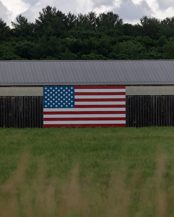 The American Flag draped over the Massachusetts State Police horse barn in Acton.