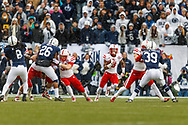 Snow begins to fall as Ameer Abdullah finds a seam at Penn State on Nov. 23, 2013. © Aaron Babcock