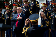 """President Donald Trump sings the National Anthem during a """"Celebration of America"""" event on the South Lawn of the White House on June 5, 2018 in Washington, DC. The celebration is being staged as a replacement for a White House visit by the Super Bowl champion Philadelphia Eagles. Some of the team was planning on boycotting the event due to the President's stance on players kneeling during the National Anthem at NFL games, so Trump resented their invitation.      Photo by Pete Marovich/UPI"""