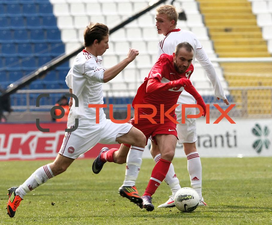 Turkey U21's Sercan Yildirim (C) during their friendly soccer match Turkey U21 betwen Denmark U21 at Recep Tayyip Erdogan stadium in Istanbul February 29, 2012. Photo by TURKPIX
