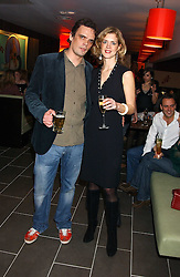 MARK VON WESTENHOLZ and his wife MILLIE at the opening party for a new bowling alley All Star Lanes, at Victoria House, Bloomsbury Place, London on 19th January 2006.<br />